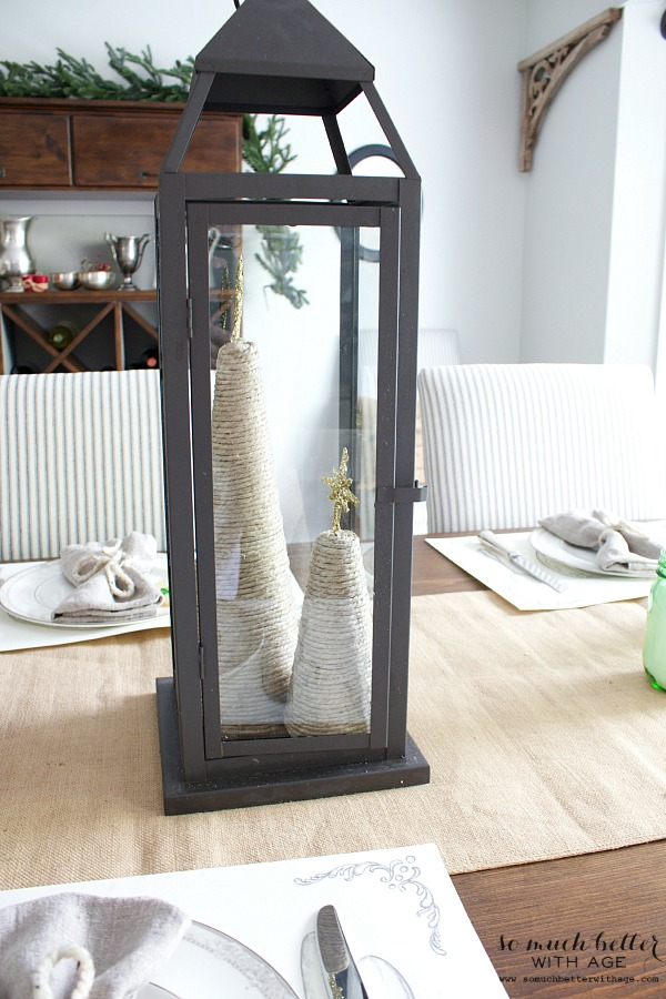 Black lantern and twine Christmas trees by somuchbetterwithage.com