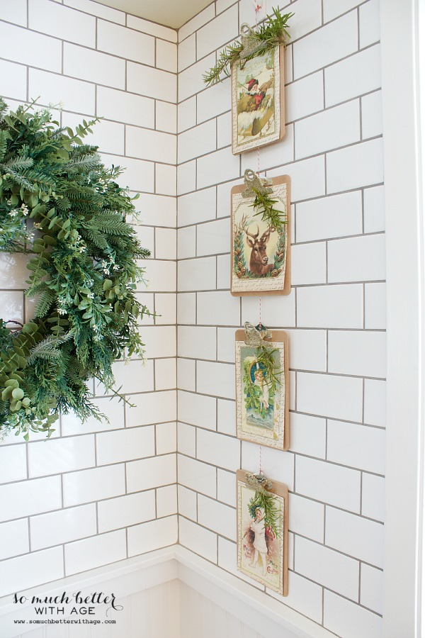 Vintage Vertical Christmas Garland / pictures hanging on subway tile - So Much Better With Age