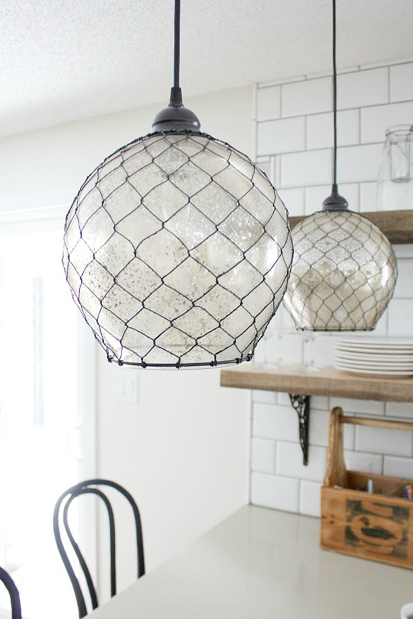 Gorgeous pendant lights (Kenroy) by somuchbetterwithage.com