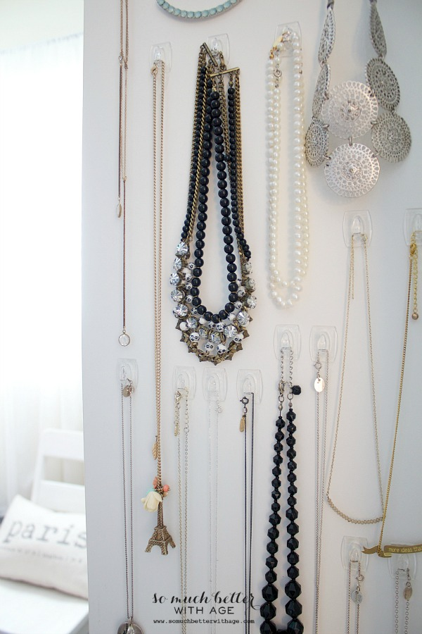 Necklaces hanging on hooks.