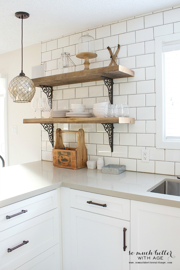 white subway tile and rustic shelves by somuchbetterwithagecom - Industrial Kitchen