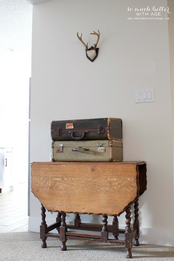 Old suitcases and antlers | somuchbetterwithage.com