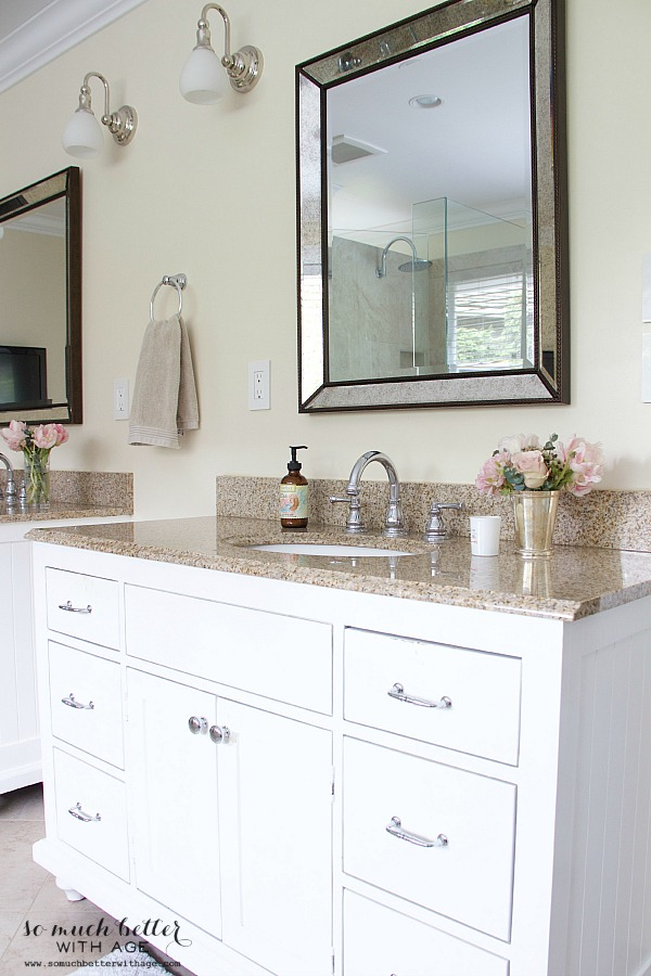 White custom wood vanities in bathroom.