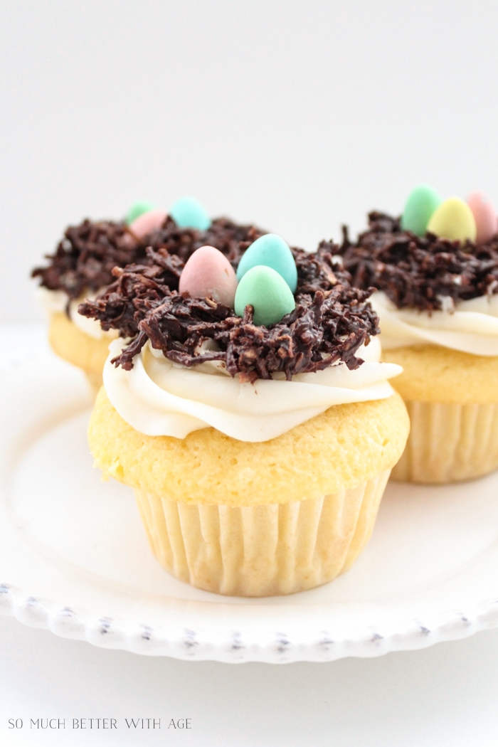 Vanilla cupcakes with chocolate Easter eggs and chocolate nests.