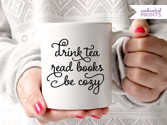 Enchanted Prints mugs with sayings on the front.