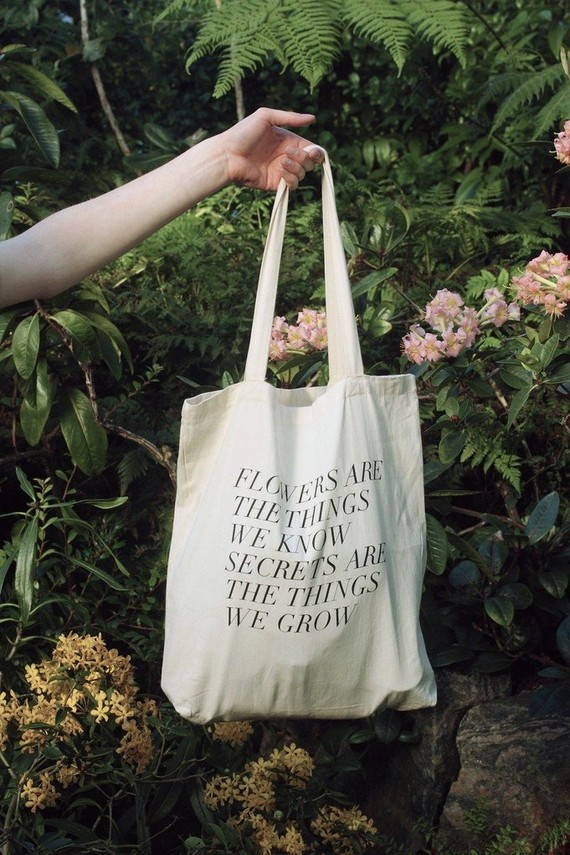 Field Guided tote bag with saying on the front of bag.