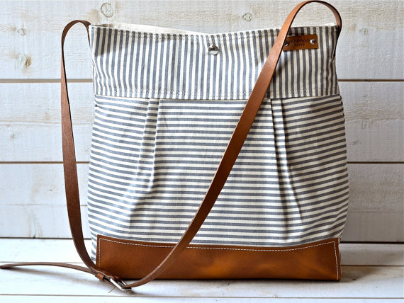 Ikabags tote with stripes and a brown leather handle.