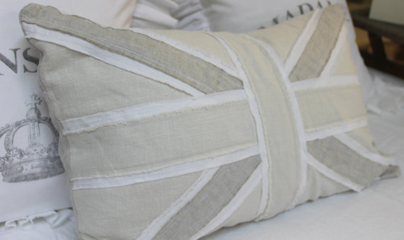 Ticking and Toile pillow  in neutral colors.