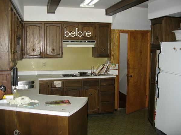 Wooden brown cabinets in the kitchen with white counters.