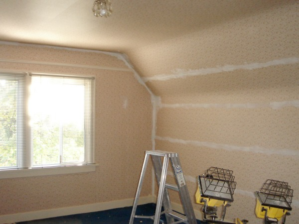 Taking down the wallpaper in the nursery.