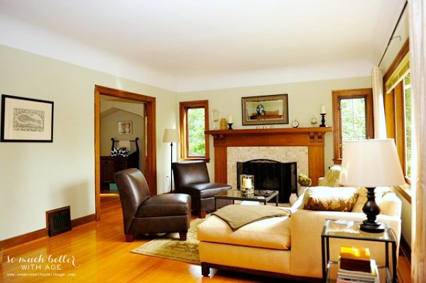 Updated wooden floor in living room with comfy looking couches and leather chairs.