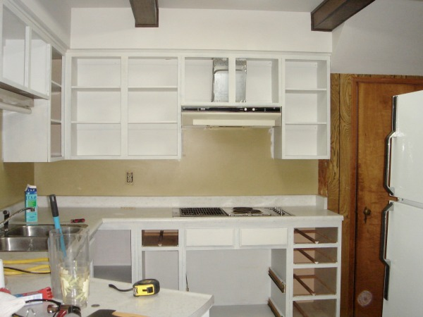 Ripping our the cabinets in kitchen and painting it white.