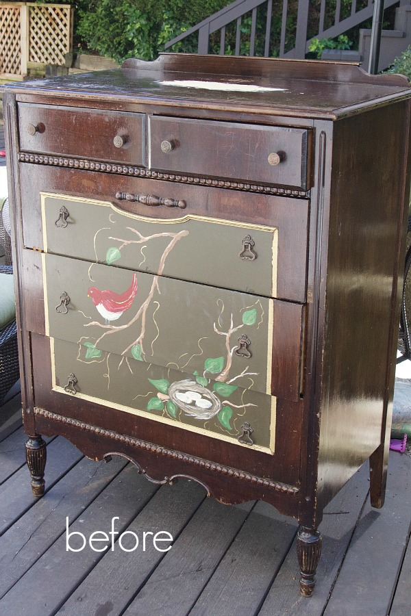 Dresser that is brown with a bird motif on front.