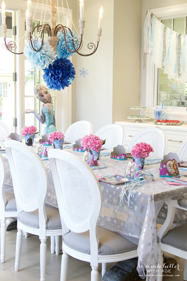 Elegant Frozen Birthday Party / pink flowers on table - So Much Better With Age