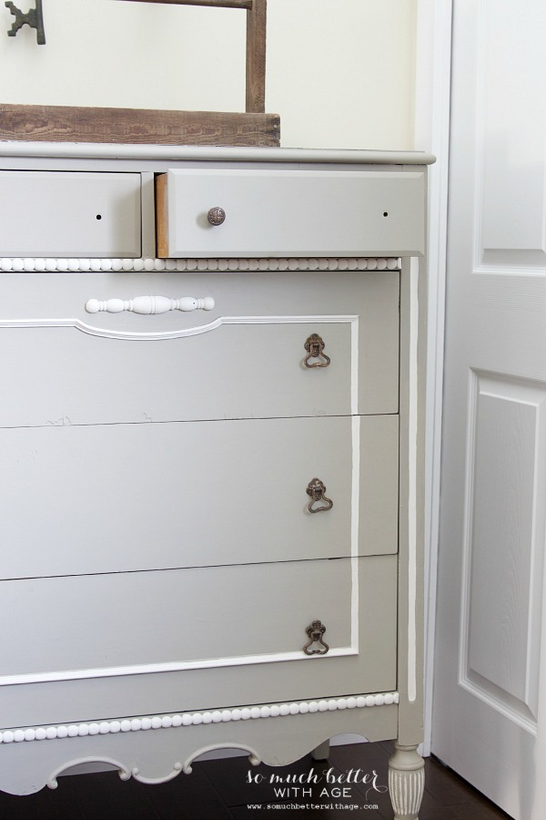 White and gray dresser with French details.