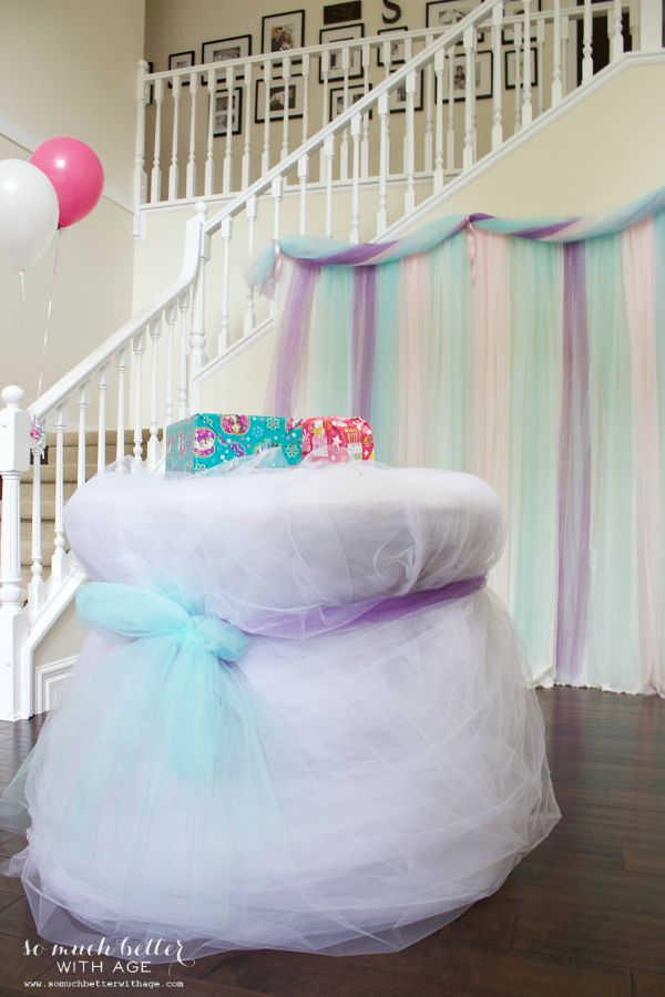 Frozen DIY photo backdrop / table wrapped in tulle - So Much Better With Age