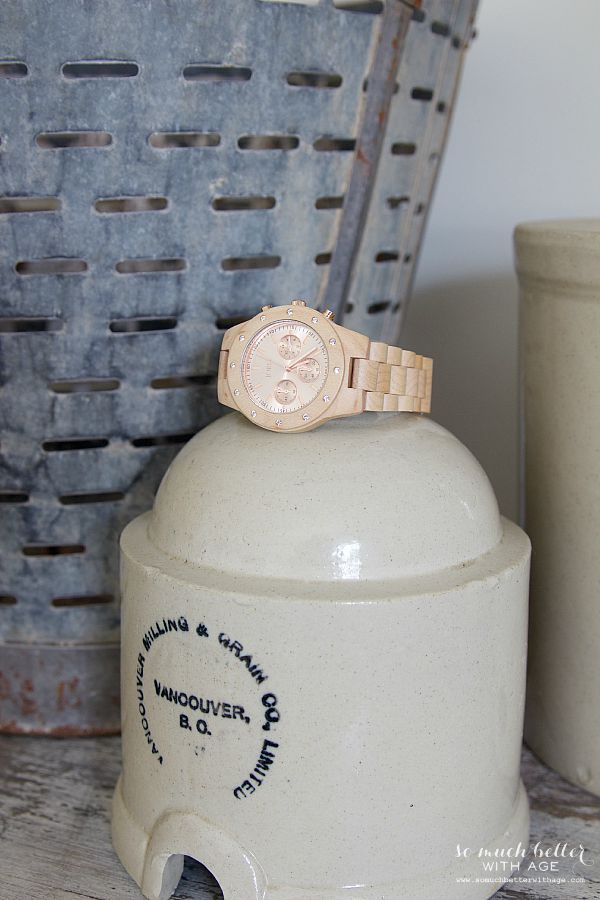 Rose gold and wood watch with neutral decor