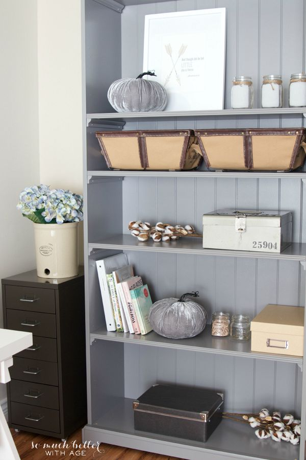Gray neutral shelf with books on it.