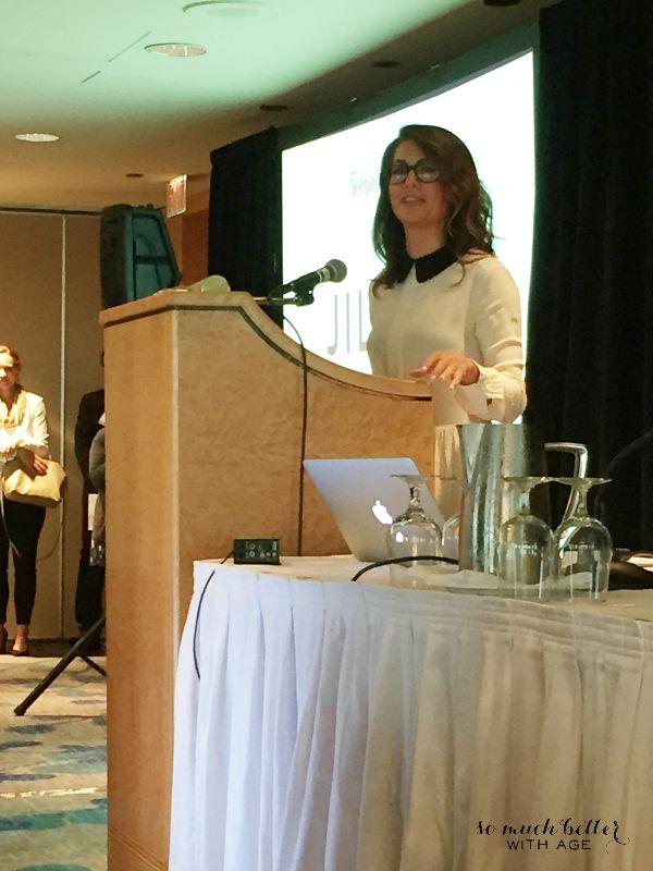 Jillian Harris giving a speech at front of the room.