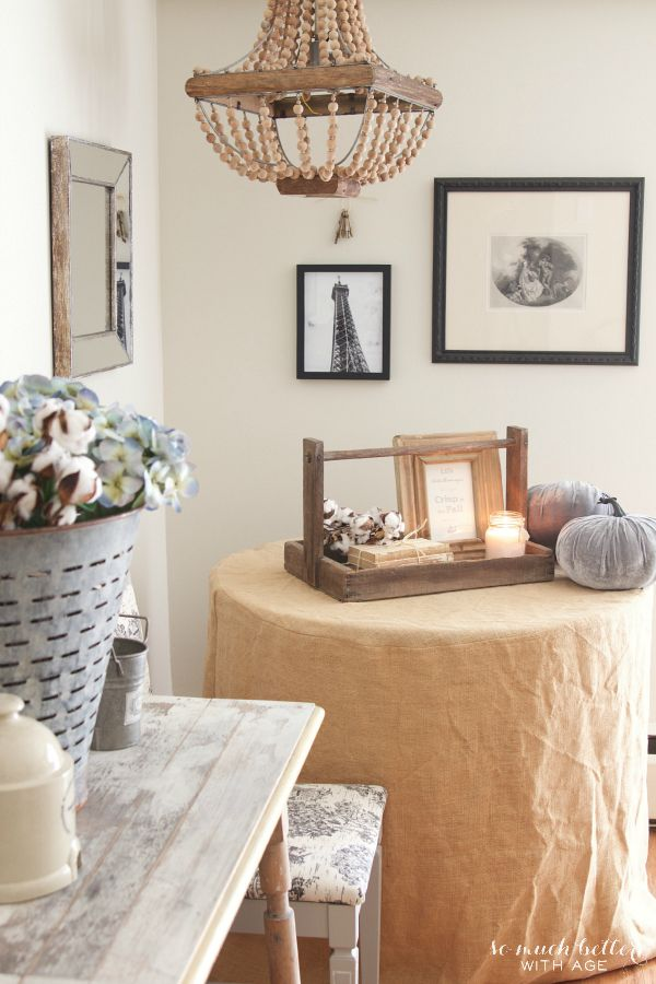 Burlap tablecloth on side table in living room.