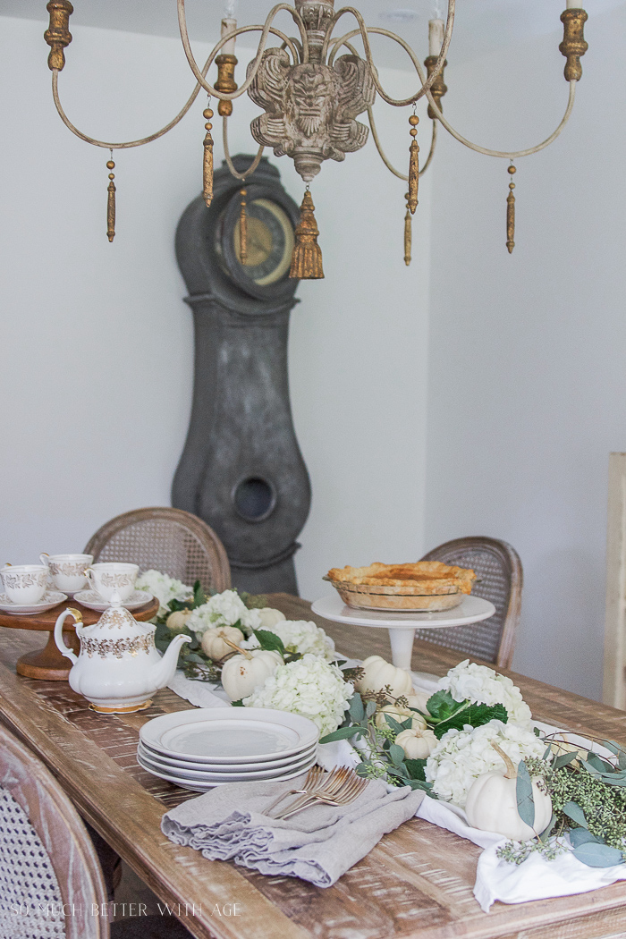 Mora clock and Thanksgiving table setting with French decor and carrot pie recipe
