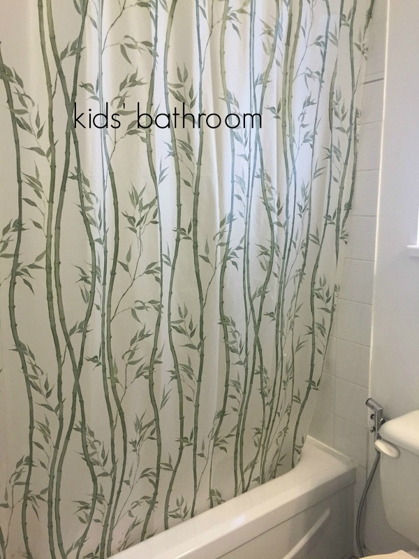 A bamboo shower curtain in the kids bathroom.