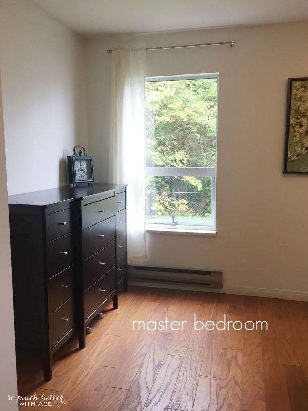 A wooden floor is in the master bedroom.