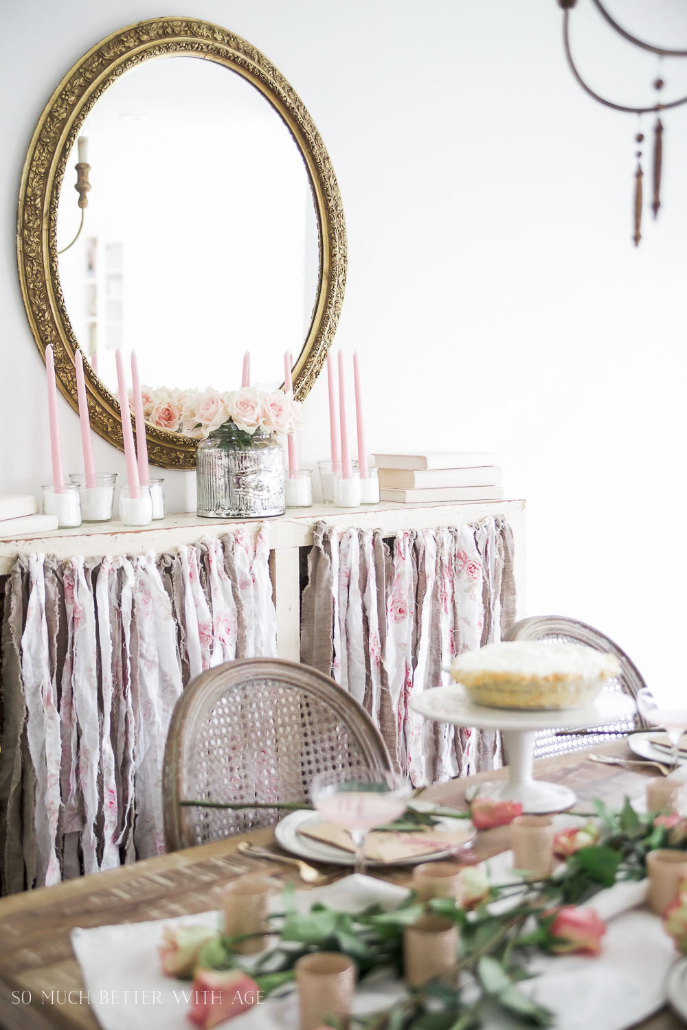 Pretty pink roses Valentine's Day table setting / antique mirror hanging in dining room - So Much Better With Age