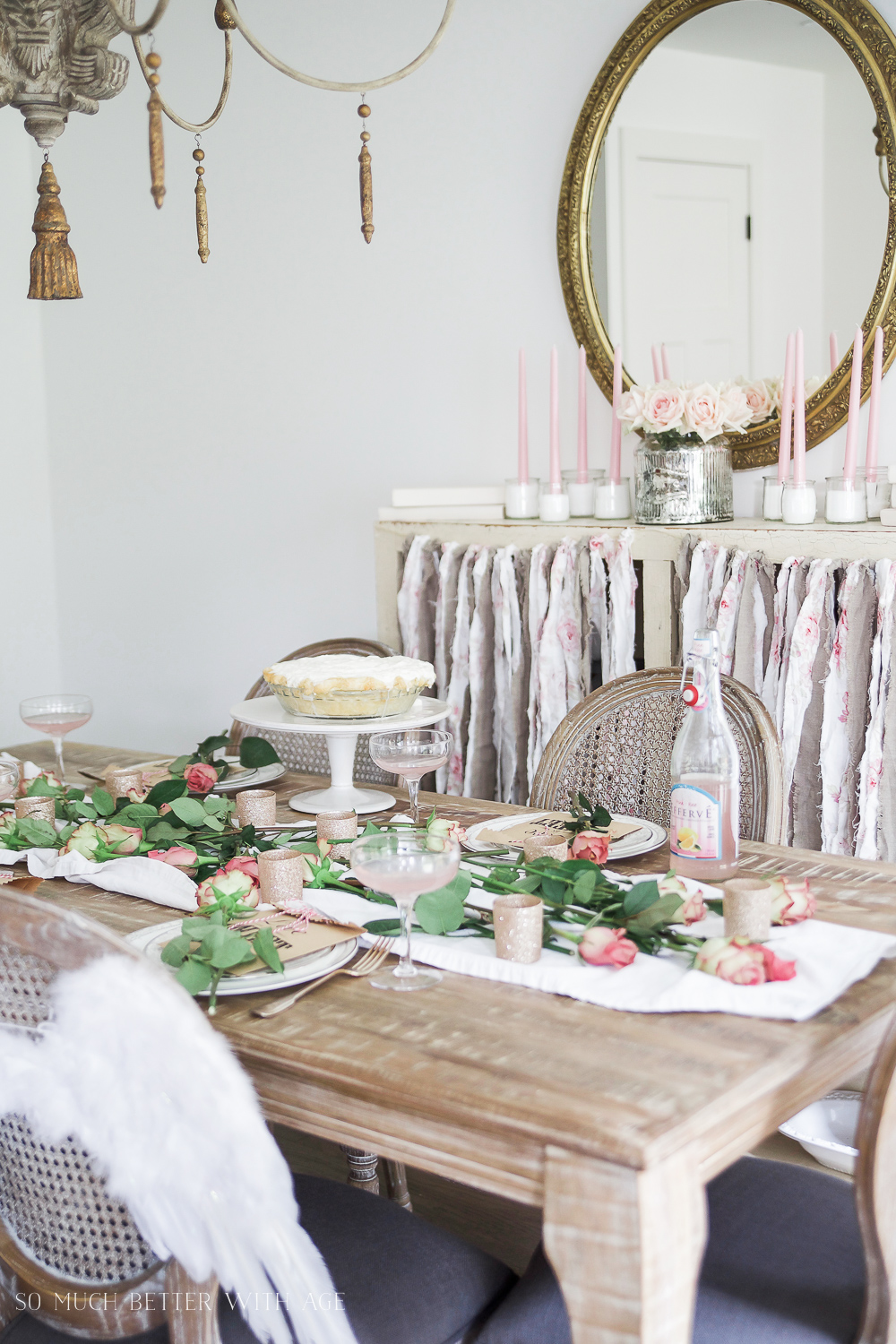 Pretty pink roses Valentine's Day table setting with angel wings