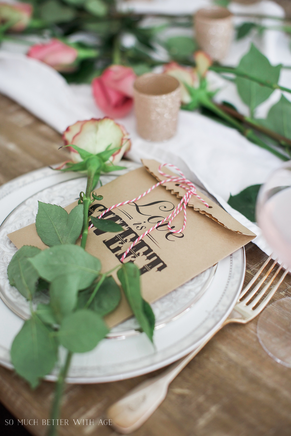 Pretty pink roses Valentine's Day table setting / cute gift bags on table - So Much Better With Age