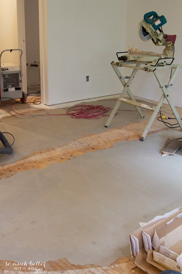 Hardwood floors, new fireplace and kitchen hardware / concrete on the floor - So Much Better With Age
