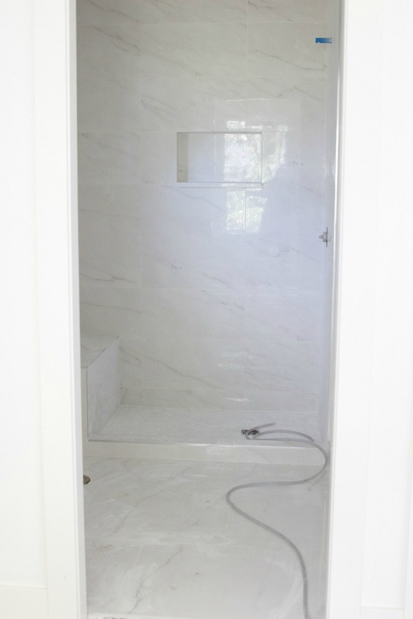 The inside of the shower stall.