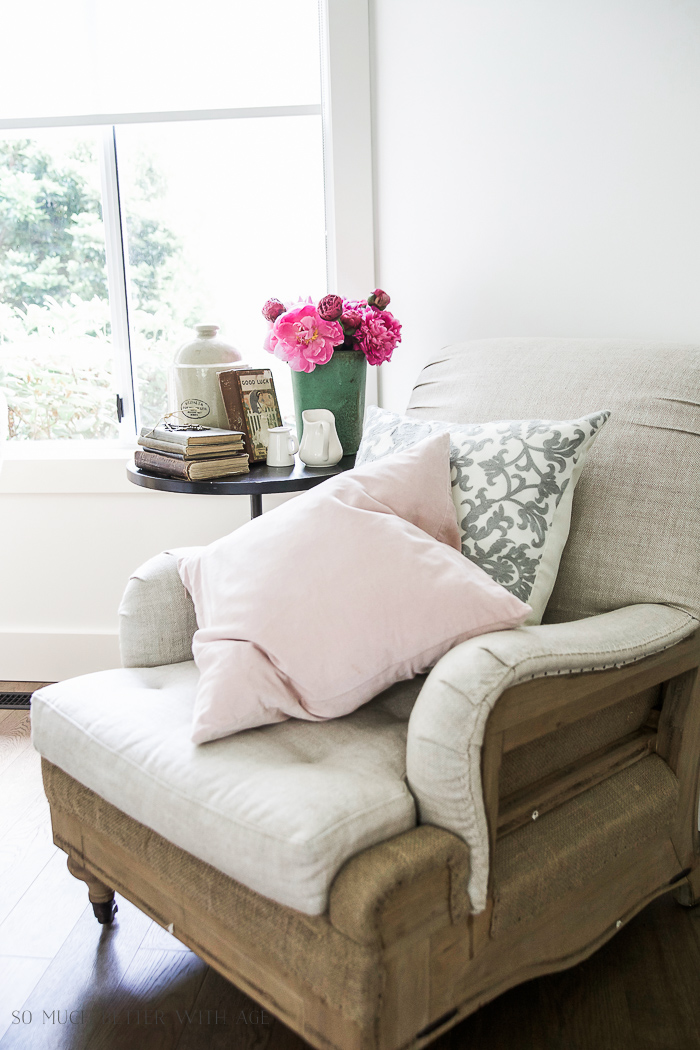 Pink and grey pillows on armchair.