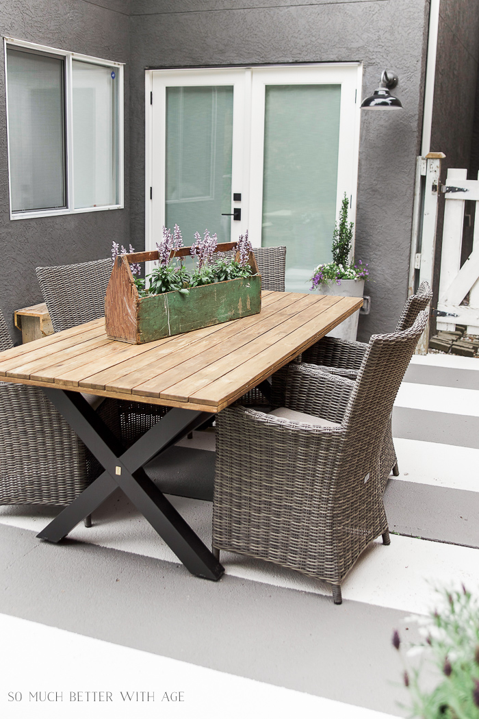 Outdoor wooden table and chairs around it.