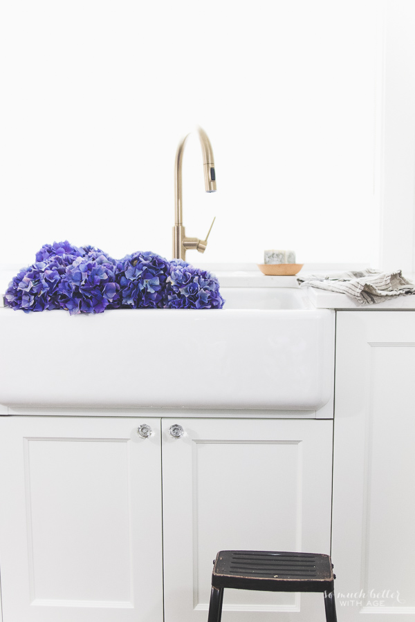 Beautiful flowers & kitchen details, Delta Trinsic faucet, Kohler apron-front sink