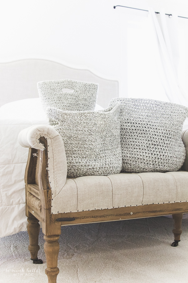 Decorating the master bedroom with grey and white crocheted baskets