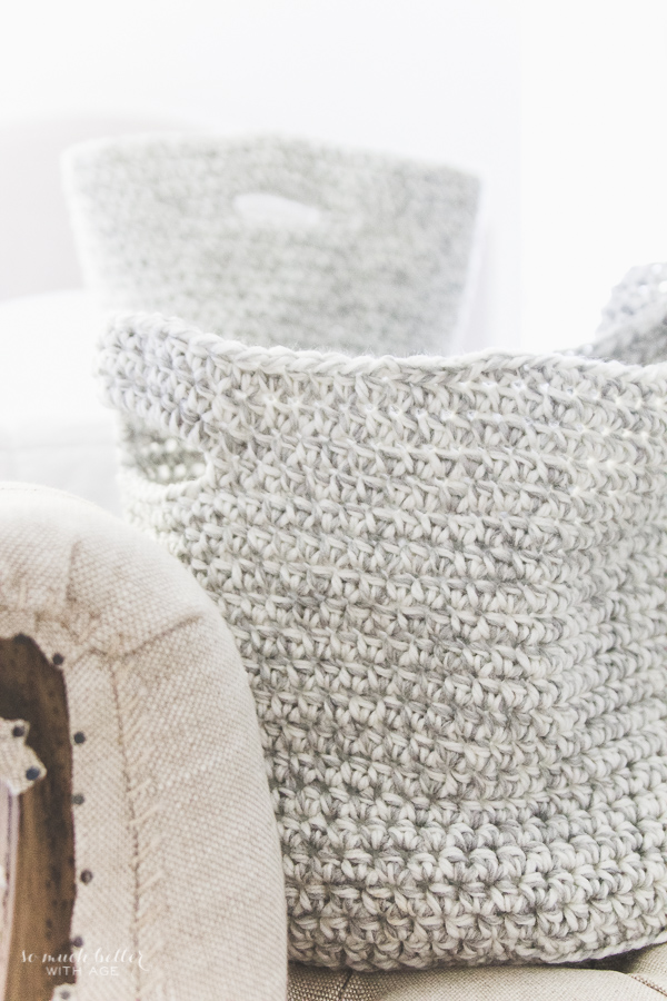Beautiful grey and white crocheted baskets, decorating the master bedroom