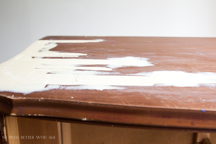 Sanded wood putty on top of furniture.
