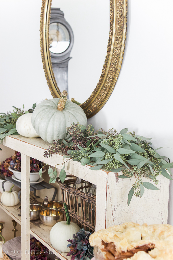 French gold mirror, Mora clock, heirloom pumpkins, seeded eucalyptus