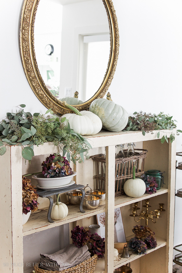 French Country Fall Dining Room / French gold mirror and heirloom pumpkins with seeded eucalyptus on shelf - So Much Better With Age