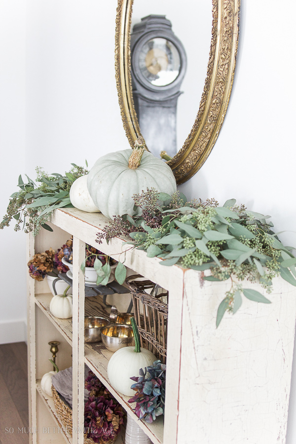 French Country Fall Dining Room / Heirloom pumpkins with seeded eucalyptus and gold mirror, Mora clock - So Much Better With Age