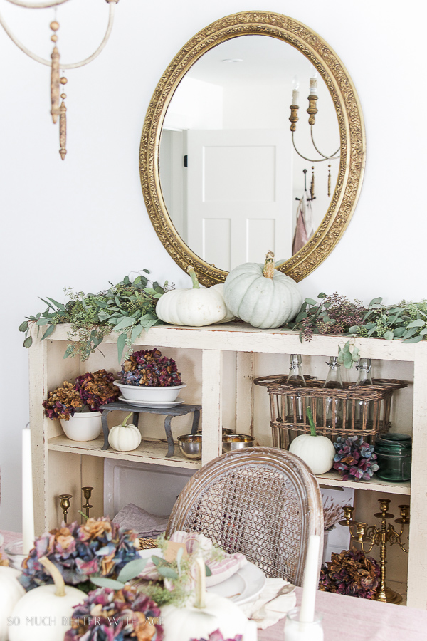 French Country Fall Dining Room / French gold mirror from Soft Surroundings with heirloom pumpkins, hydrangea and seeded eucalyptus - So Much Better With Age