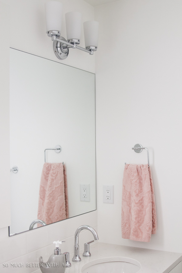 Simple clean and white kids bathroom reveal / Modern white bathroom pink towels - So Much Better With Age
