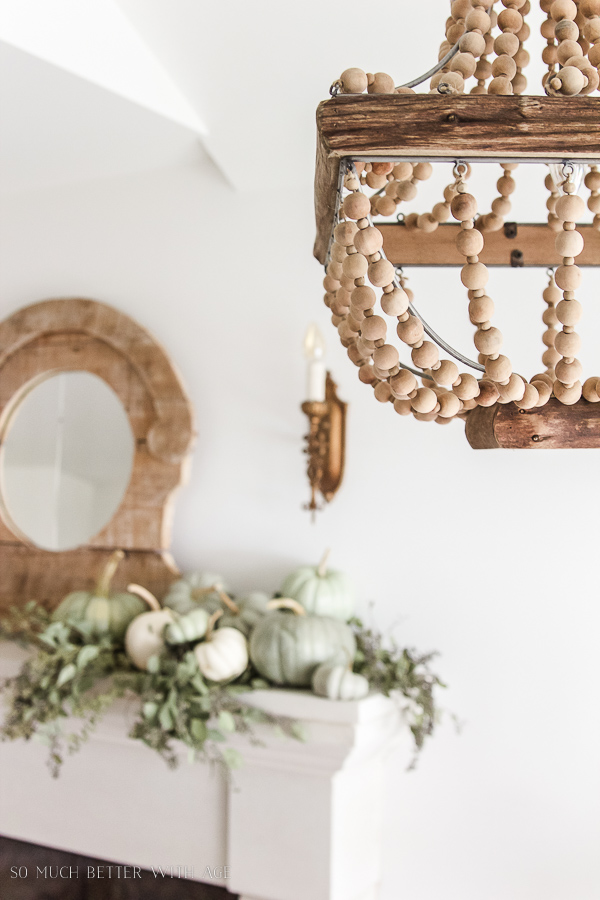 DIY heirloom pumpkin tutorial /heirloom pumpkins on mantel with seeded eucalyptus and beaded chandelier - So Much Better With Age