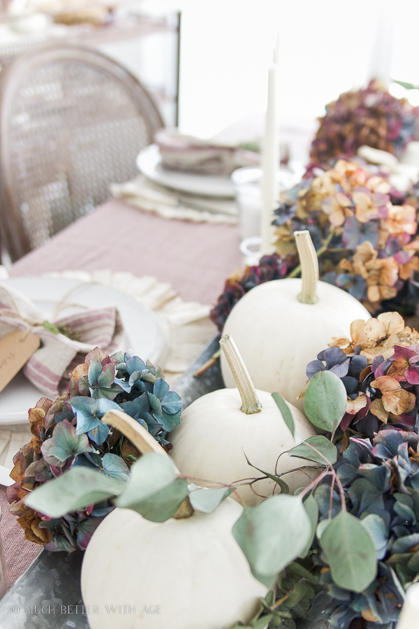White pumpkins, purple hydrangea tablescape in French country dining room