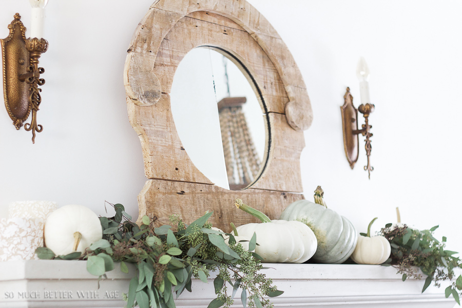 French Fall Home Tour with Purple and Green / French limestone mantel, neutral decor, heirloom pumpkins, seeded eucalyptus, and wall sconce - So Much Better With Age