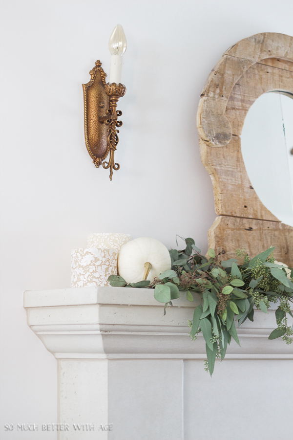 French Fall Home Tour with Purple and Green / French limestone mantel, neutral decor, heirloom pumpkins, seeded eucalyptus and gold wall sconce - So Much Better With Age