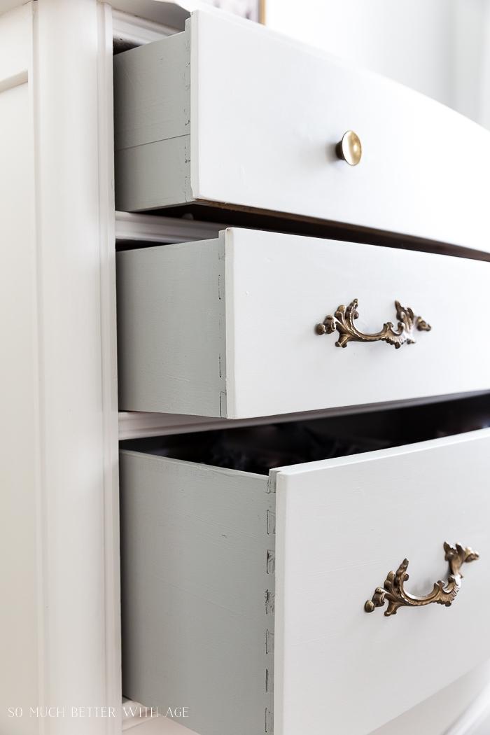 Gold handles on dresser.
