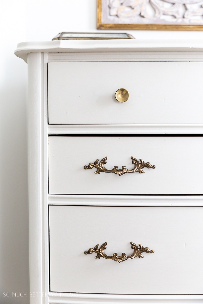 Cream dresser with gold handles.