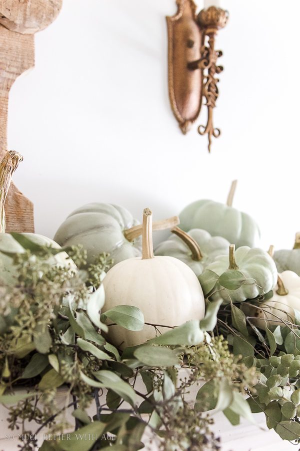 DIY heirloom pumpkin tutorial /Heirloom pumpkins and seeded eucalyptus on mantel - So Much Better With Age